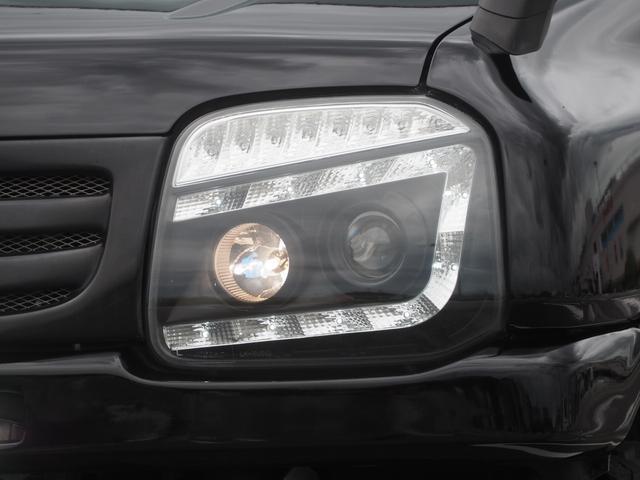 XC リフトアップ 16AW GEOLANDAR M/Tタイヤ 社外マフラー 社外ヘッドライト LEDテール 社外ステアリング ナビ DVD シートカバー(9枚目)