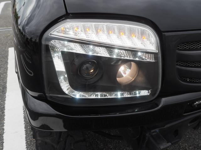 XC リフトアップ 16AW GEOLANDAR M/Tタイヤ 社外マフラー 社外ヘッドライト LEDテール 社外ステアリング ナビ DVD シートカバー(58枚目)