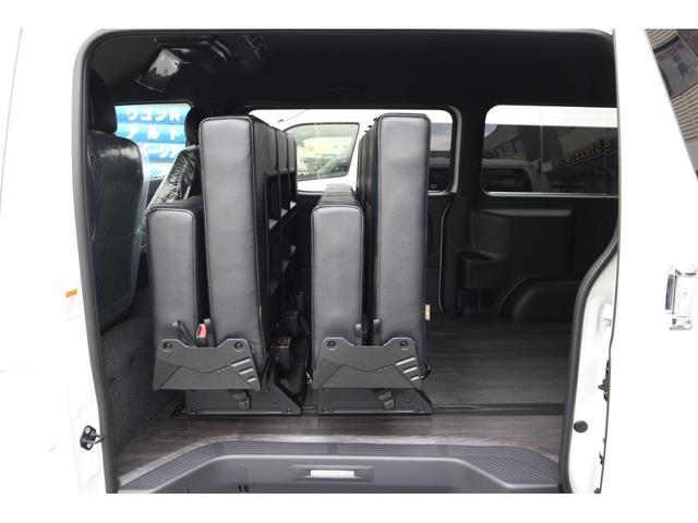スーパーGL ダークプライムII 2.8D-Tワイド3列REVOシート2脚1ナンバー8人ロングスライドレールフロアフローリングパナソニック10inナビカロッツエリアフリップダウンモニターパノラマミックビューモニター車中泊アウトドア仕様(21枚目)
