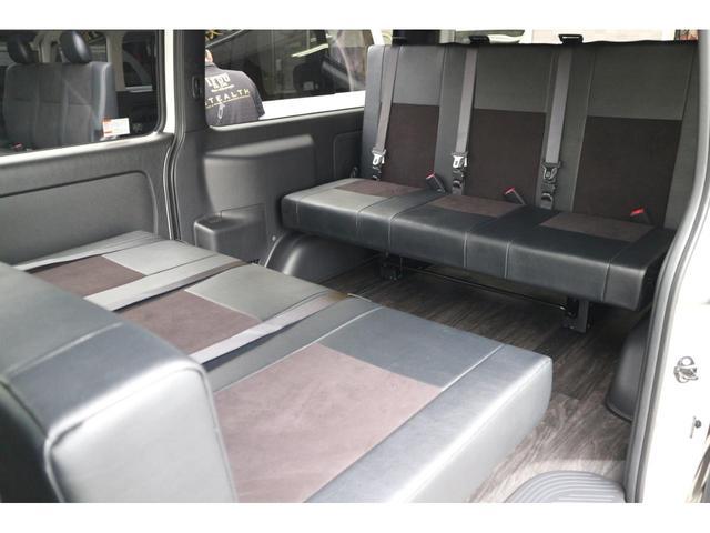 スーパーGL ダークプライムII 2.8D-Tワイド3列REVOシート2脚1ナンバー8人ロングスライドレールフロアフローリングパナソニック10inナビカロッツエリアフリップダウンモニターパノラマミックビューモニター車中泊アウトドア仕様(24枚目)