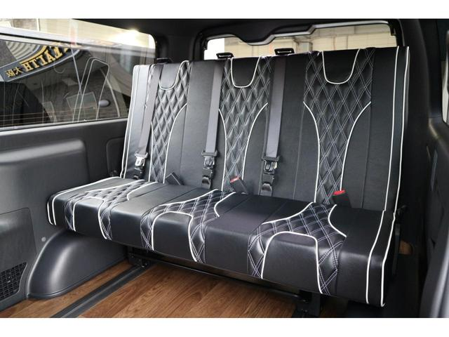 スーパーGL ダークプライムII 3列REVOシート2脚5ナンバー乗用車登録8人フローリングロングスライドレール10inナビHDMI対応フリップダウンモニターフルフラットベット対面ラウンジ展開ウッドインテリアLEDテール17inアルミ(24枚目)