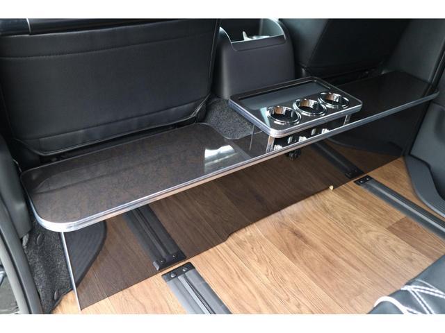 スーパーGL ダークプライムII 3列REVOシート2脚5ナンバー乗用車登録8人フローリングロングスライドレール10inナビHDMI対応フリップダウンモニターフルフラットベット対面ラウンジ展開ウッドインテリアLEDテール17inアルミ(30枚目)