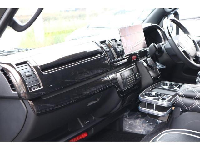 スーパーGL ダークプライムII 3列REVOシート2脚5ナンバー乗用車登録8人フローリングロングスライドレール10inナビHDMI対応フリップダウンモニターフルフラットベット対面ラウンジ展開ウッドインテリアLEDテール17inアルミ(36枚目)