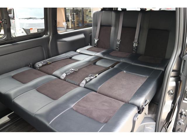 スーパーGL ダークプライムII 2.8D-T2WD3列REVOシート2脚4ナンバー8人フロアフローリングロングスライドレールフルフルラットベット対面ラウンジ展開フルセグナビフリップダウンモニターパノラマモニター車中泊アウトドア仕様(24枚目)