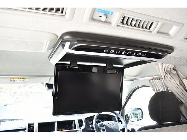 トヨタセーフティセンス キーレス パワースライドドア ステアリングスイッチ レザーシート加工 シンク 冷蔵庫 15インチフリップダウンモニター ナビ切替スイッチ 運転席・助手席コの字カーテン(33枚目)