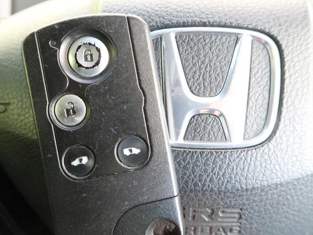 Z 純正ナビ フリップダウンモニター マルチビューカメラ 両側電動スライド 禁煙車 HIDヘッドライト オートライト スマートキー オートエアコン リアクーラー イージークローザー ECON(7枚目)