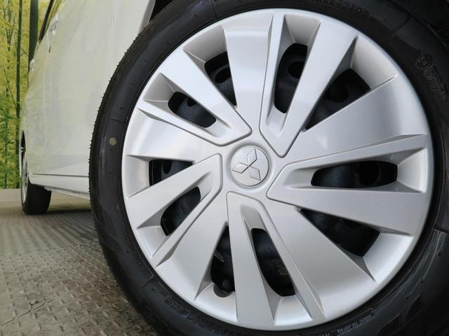 M 禁煙車 前席シートヒーター 横滑り防止装置 アイドリングストップ ヘッドライトレベライザー 純正CDオーディオ プライバシーガラス 電動格納ミラー パワーウィンドウ(11枚目)