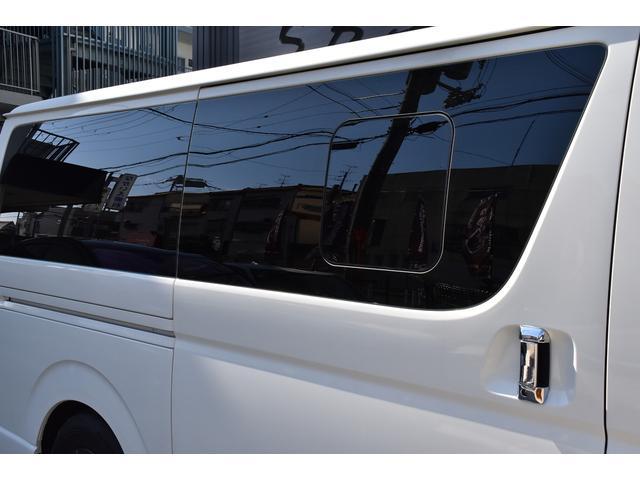 ロングDX オリジナルカスタムコンプリートVer.1 6人乗り 両スラ ベッドキット 木目調インテリアパネル&コンビハンドル 純正ナビ ETC スモークテール バッドフェイス ブラックエンブレム ローダウン(8枚目)