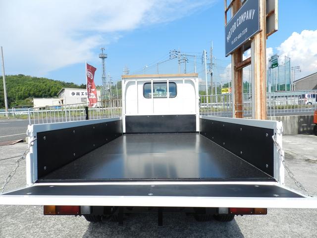 6速MT マニュアル 低床 カスタム メッキグリル スマートキー 両側電動格納ミラー 純正HID オートA/C フォグライト カスタム専用シート 安全装置(4枚目)