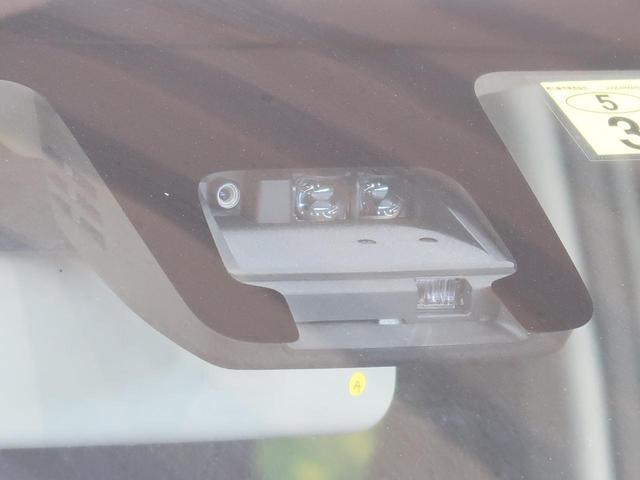 ハイブリッドFX ワンオーナー 禁煙車 デュアルセンサーブレーキ シートヒーター 後退時サポートセンサー 車線逸脱警報 スマートキー オートエアコン オートライト アイドリングストップ 横滑防止 SRSエアバック(7枚目)