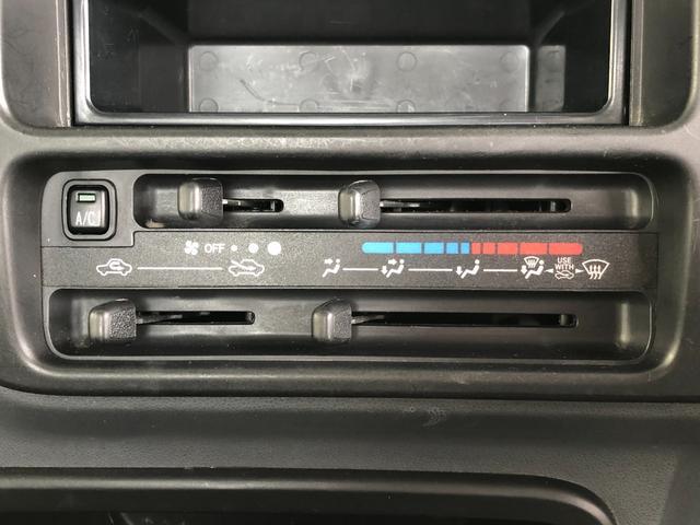 エアコン・パワステ スペシャル 4WD・エアコン・パワステ・5速MT・荷台三方開・ラバーマット・純正フロアマット&ドアバイザー・純正オーディオ・FMラジオ・ヘッドライトレベライザー・走行距離1万km台(17枚目)