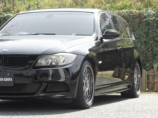 325iツーリング ハイラインパッケージ 正規ディーラー車/右ハンドル/黒革シート/BMWパフォーマンスパーツ/車高調/エアクリ/REMUSマフラー/HDDナビ バックカメラ/キセノン/キーレス(65枚目)