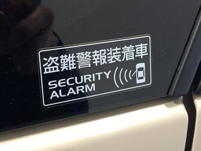 システム作動中にキーレスエントリー以外の操作で解除しドアを開くとハザードランプとホーンで警告。