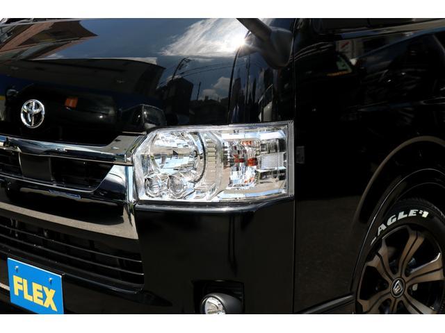 ロングDX GLパッケージ FLEXキャンピングカーNH TYPEII 車中泊 走行充電システム サブバッテリー カーテン フロントスポイラー 上開き式冷蔵冷凍庫40L 間接照明ダウンライト  アーバングランデ17インチAW(6枚目)