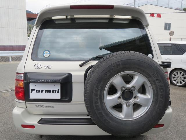 トヨタ ランドクルーザー100 VXリミテッド サンルーフ ハーフエアロ 背面タイヤ