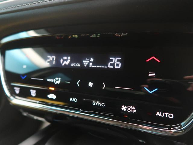 ハイブリッドX・ホンダセンシング 純正8型ナビ 1オーナー 禁煙車 ホンダセンシング 衝突被害軽減装置 レーダークルーズコントロール 車線逸脱警報装置 バックカメラ ETC ステアリングスイッチ 革巻きステアリング スマートキー(48枚目)