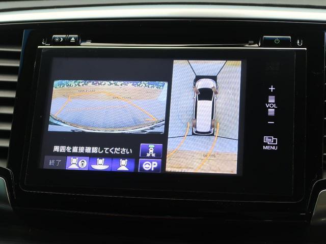 ハイブリッドアブソルート・ホンダセンシングEXパック メーカーナビ 天吊モニター 全周囲カメラ 両側電動ドア ホンダセンシング/アダプティブクルーズコントロール 黒革/シートヒーター コーナーセンサー 禁煙車 LEDヘッド 純正17AW スマートキー(7枚目)