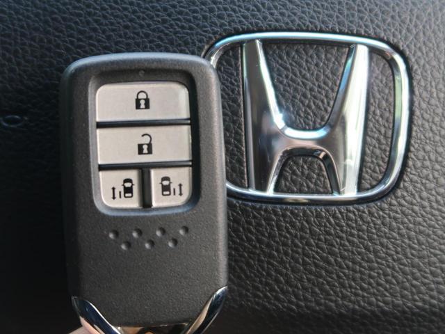ハイブリッドアブソルート・ホンダセンシングEXパック メーカーナビ 天吊モニター 全周囲カメラ 両側電動ドア ホンダセンシング/アダプティブクルーズコントロール 黒革/シートヒーター コーナーセンサー 禁煙車 LEDヘッド 純正17AW スマートキー(65枚目)