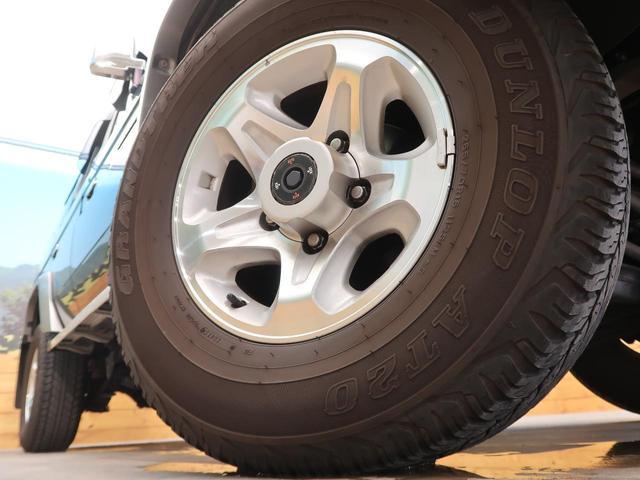 バン SDナビ 電動デフロック 5MT 背面タイヤ 4WD 1オーナー 禁煙車 ETC サイドステップ マニュアルエアコン/リアヒーター 純正16AW ベンチシート Bluetooth接続可(14枚目)