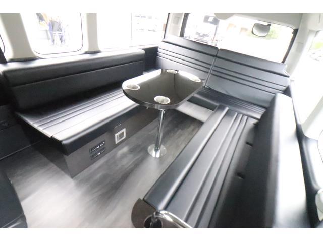 グランドキャビン セカンドハウス製 10人乗り 3ナンバー 2.7L ガソリン SDナビ ETC フリップダウンモニター リヤクーラー・ヒーター 20AW スマートキー 電動スライドドア テーブル 展開式ベッド(3枚目)