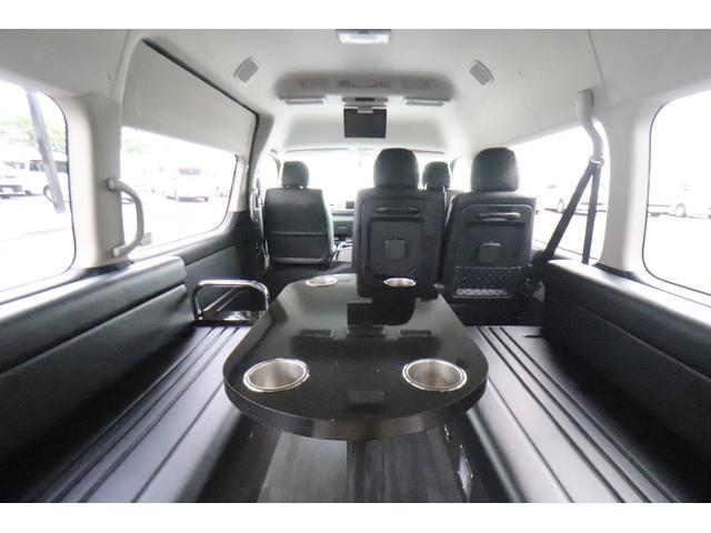 グランドキャビン セカンドハウス製 10人乗り 3ナンバー 2.7L ガソリン SDナビ ETC フリップダウンモニター リヤクーラー・ヒーター 20AW スマートキー 電動スライドドア テーブル 展開式ベッド(4枚目)
