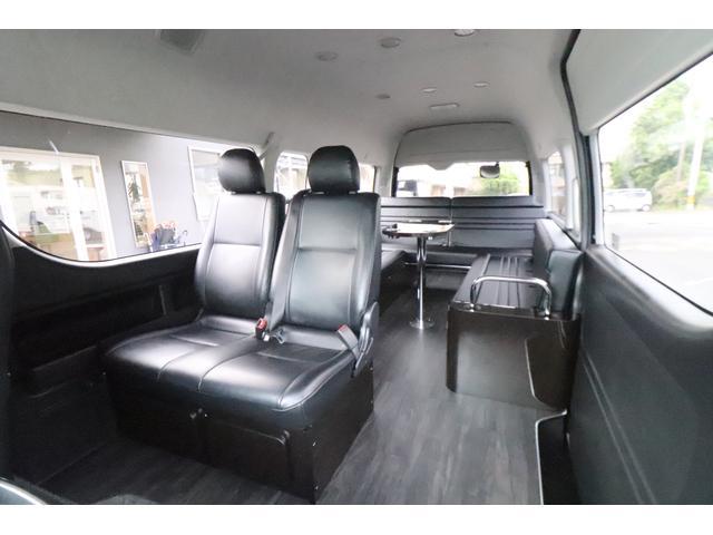 グランドキャビン セカンドハウス製 10人乗り 3ナンバー 2.7L ガソリン SDナビ ETC フリップダウンモニター リヤクーラー・ヒーター 20AW スマートキー 電動スライドドア テーブル 展開式ベッド(5枚目)