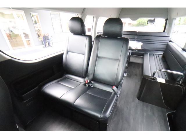 グランドキャビン セカンドハウス製 10人乗り 3ナンバー 2.7L ガソリン SDナビ ETC フリップダウンモニター リヤクーラー・ヒーター 20AW スマートキー 電動スライドドア テーブル 展開式ベッド(6枚目)