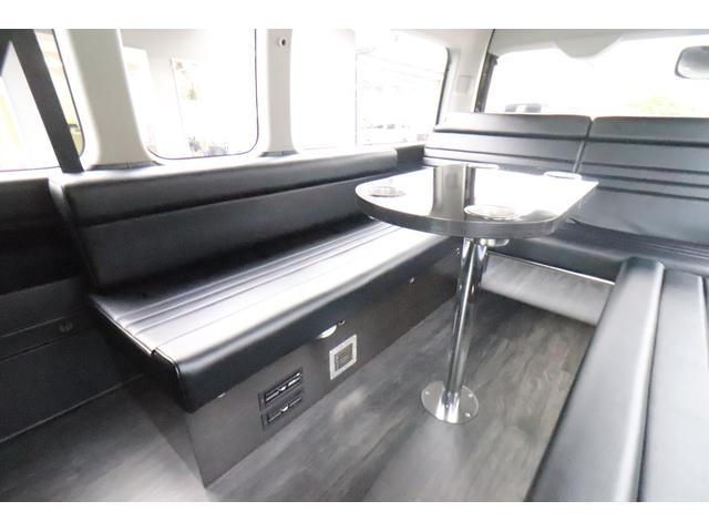 グランドキャビン セカンドハウス製 10人乗り 3ナンバー 2.7L ガソリン SDナビ ETC フリップダウンモニター リヤクーラー・ヒーター 20AW スマートキー 電動スライドドア テーブル 展開式ベッド(7枚目)