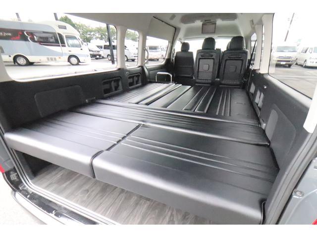 グランドキャビン セカンドハウス製 10人乗り 3ナンバー 2.7L ガソリン SDナビ ETC フリップダウンモニター リヤクーラー・ヒーター 20AW スマートキー 電動スライドドア テーブル 展開式ベッド(11枚目)
