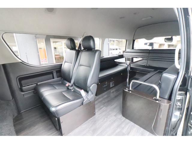 グランドキャビン セカンドハウス製 10人乗り 3ナンバー 2.7L ガソリン SDナビ ETC フリップダウンモニター リヤクーラー・ヒーター 20AW スマートキー 電動スライドドア テーブル 展開式ベッド(30枚目)
