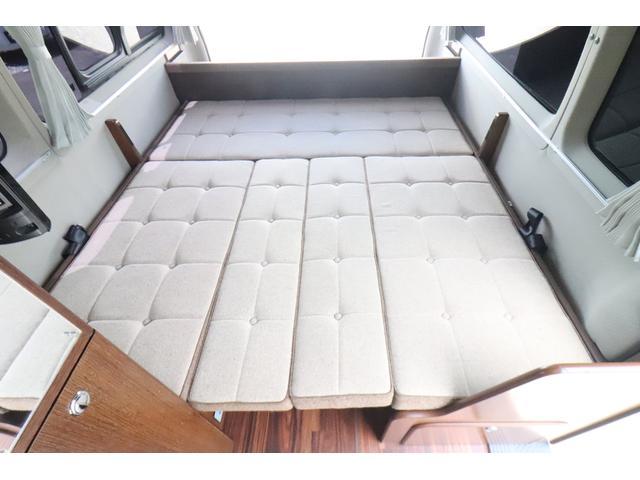 キャンピングカー ビークル デュオ タイプC 9人乗り FFヒーター TV 冷蔵庫 外部電源 ツインサブバッテリー 1500Wインバーター 4WD SDナビ LEDヘッドライト シンク カセットコンロ 強化スタビライザー(12枚目)