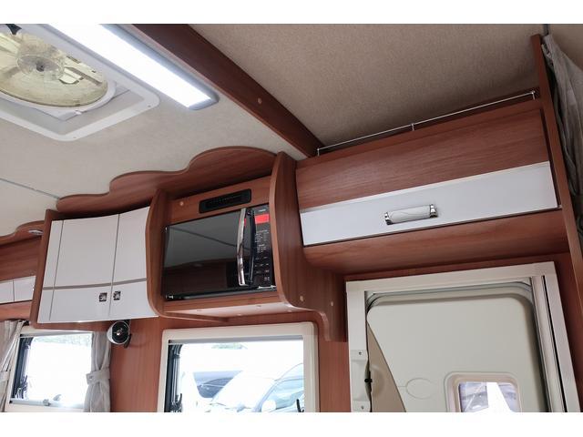 ナッツRV クレアエボリューション 5.0XX キャンピングカー 軽油 6名乗車 FFヒーター インバーター ソーラーパネル TV 電子レンジ トリプルサブバッテリー 家庭用エアコン 1500Wインバーター 外部電源 メモリーナビ バックモニター(5枚目)