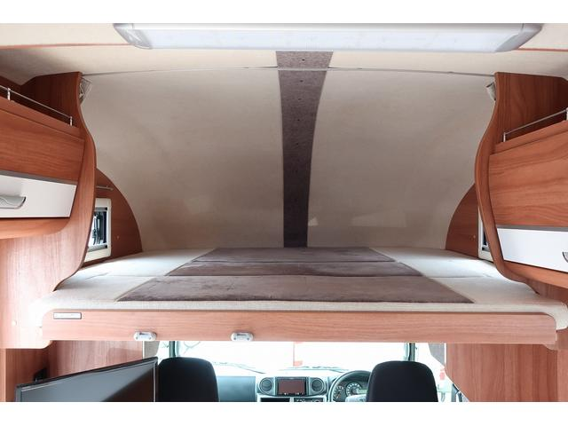 ナッツRV クレアエボリューション 5.0XX キャンピングカー 軽油 6名乗車 FFヒーター インバーター ソーラーパネル TV 電子レンジ トリプルサブバッテリー 家庭用エアコン 1500Wインバーター 外部電源 メモリーナビ バックモニター(11枚目)