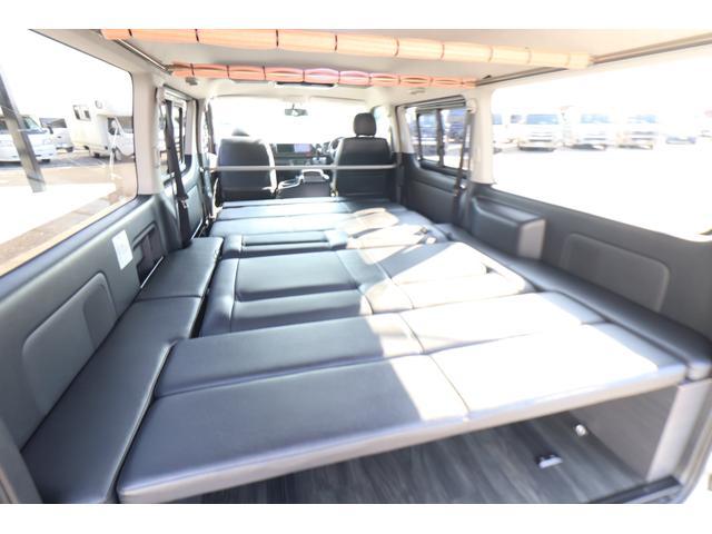 バンコン ダイレクトカーズ製 8人乗り 1ナンバー SDナビ バックカメラ ETC フリップダウンモニター リヤクーラー リヤヒーター フルフラットベッド 両側スライドドア ホワイトパールクリスタルシャイン 6AT オートエアコン(9枚目)