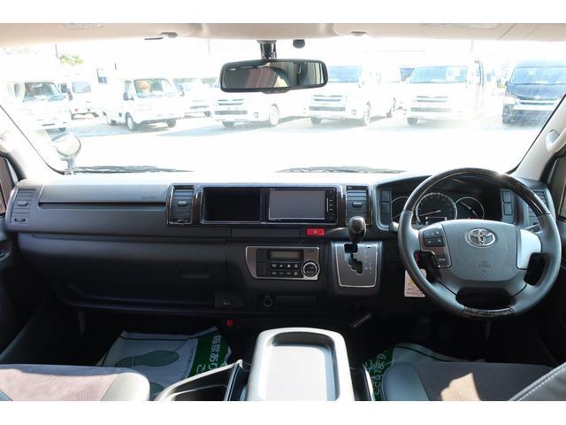 バンコン ダイレクトカーズ製 8人乗り 1ナンバー SDナビ バックカメラ ETC フリップダウンモニター リヤクーラー リヤヒーター フルフラットベッド 両側スライドドア ホワイトパールクリスタルシャイン 6AT オートエアコン(12枚目)