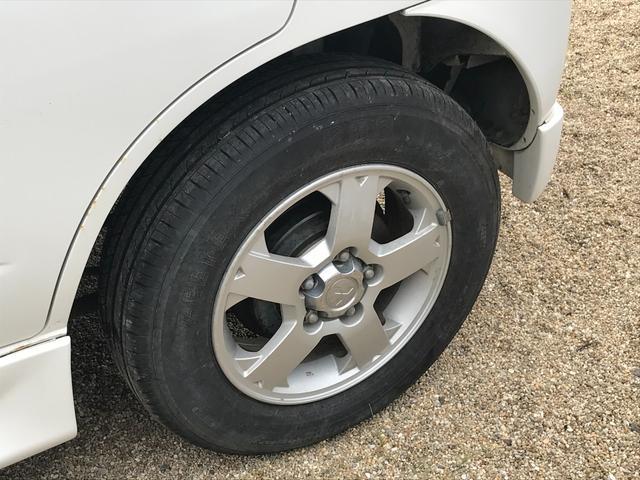 キスマークL 4WD 5速マニュアル車 車検整備付き 背面タイヤ キーレス 15インチアルミホイール(6枚目)