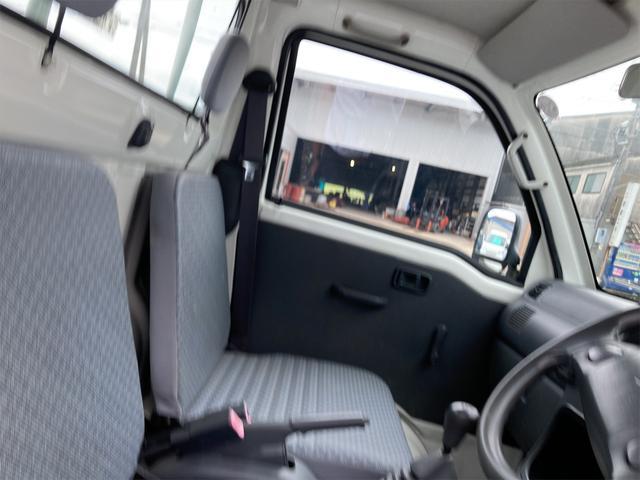 エアコン・パワステ スペシャル 4WD AC パワステ 5速MT 三方開 車検令和5年5月 ヘッドライトレベライザー 最大積載量350kg(4枚目)