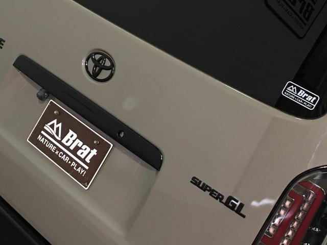 ロングスーパーGL 4WD ディーゼル NEWペイント/エメラルドグレーメタリック DEANカリフォルニア新品ホイール グッドイヤーイーグル#1ナスカー新品タイヤ セミグロスブラックアウト 後席ダークプライム専用シート(27枚目)
