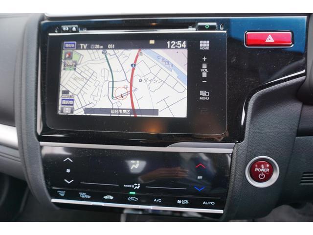 ホンダ フィットハイブリッド Fパケ 4WD禁煙車 メモリーナビTVBカメラ 衝突安全装置