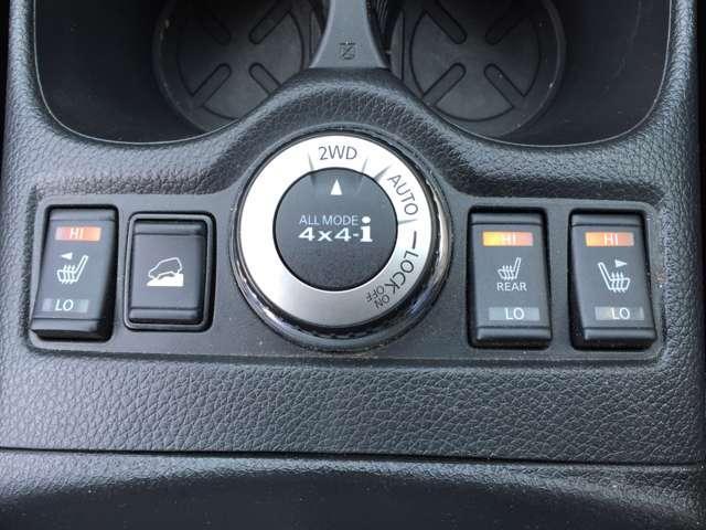 「4WDモードスイッチ」エンジン回転中に、スイッチを2WD、AUTO、LOCK ON/OFF位置に回して切り替えます。