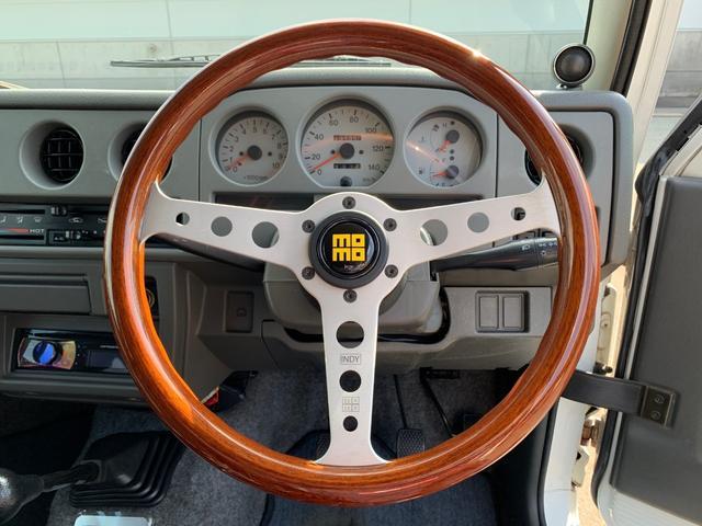 ランドベンチャー 4WD エンジンОH済 リフトアップ 5速マニュアル 記録簿 M/Tタイヤ F&Rクロカンバンパー ルーフキャリア 黒革調シートカバー MOMOステアリング ノックスドール施工済 16インチAW(3枚目)