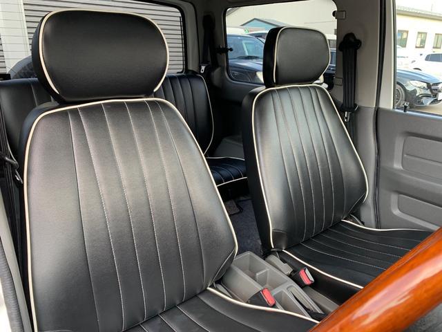 ランドベンチャー 4WD エンジンОH済 リフトアップ 5速マニュアル 記録簿 M/Tタイヤ F&Rクロカンバンパー ルーフキャリア 黒革調シートカバー MOMOステアリング ノックスドール施工済 16インチAW(13枚目)