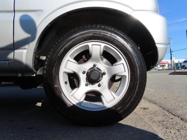 XC 4WD 5速MT 副変速機付きトランスファーレバー フォグランプ 電動格納ヒーテッドドアミラー キーレスキー ABS(56枚目)