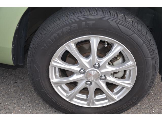 UL-X 4WD パワーウィンド 純正バックカメラ 純正リモコンエンジンスターター 横滑り防止装置 トラクションコントロール オートライト フォグランプ クラッツィオシートカバー 14インチアルミ(69枚目)