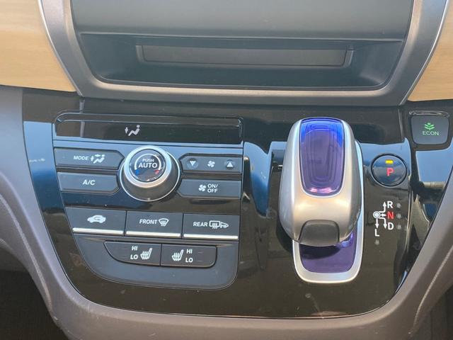 ハイブリッド・Gホンダセンシング 4WD 新品SDナビ取付 フルセグTV Bluetooth接続 バックカメラ ETC 両側電動ドア 追従クルーズ 衝突軽減 横滑り防止 スマーキー LEDライト 盗難防止 モデューロアルミ 禁煙車(27枚目)
