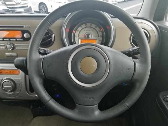 Xセレクション フルタイム4WD 禁煙車 CD再生 プッシュスタート スマートキー ETC シートヒーター 電格ミラー オートエアコン 盗難防止システム 社外14インチアルミ オートライト プライバシーガラス(24枚目)