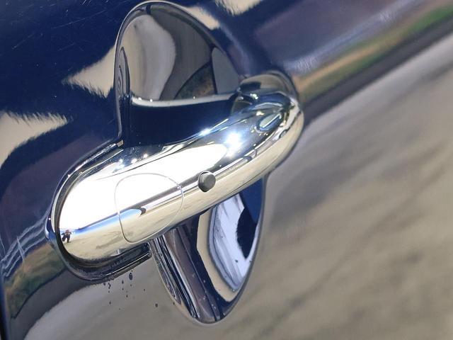 クーパーSD セブン 特別仕様車 チェック柄入りハーフレザーシート 純正17インチAW 純正HDDナビ レインセンサー オートライト LEDヘッドライト コンフォートアクセス エキサイトメントPKG ライトPKG 禁煙車(4枚目)