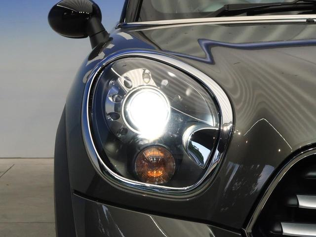 クーパー クロスオーバー 禁煙車 HIDヘッドランプ 純正AV CD再生 スマートキー 電動格納ミラー オートライト 純正16インチAW フロントリアフォグランプ オートエアコン(24枚目)