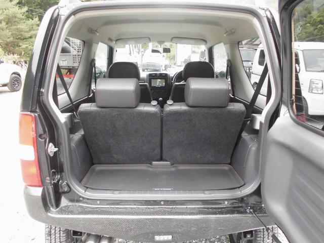 ワイルドウインド 4WDターボ リフトアップ 社外アルミ 前後社外カーボン調バンパー 社外マフラー 社外HDDナビ&フルセグテレビ&DVD&Bluetooth 専用レザーシート シートヒーター ルーフレール(52枚目)