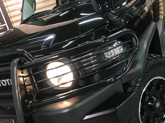 ブラックカラーパッケージ フロント2.5インチ・リア1.5インチリフトアップスペーサー 新品ジオランダーM/T 新品グリルガード 新品ルーフラック 新品LEDウインカー 新品テールランプガード 純正SDナビ フルセグ(30枚目)
